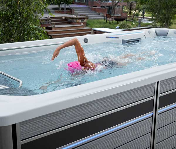 Woman swimming in E700 Endless Pool | Endless Pools Fitness Systems available at the Recreational Warehouse Southwest Florida (Naples, Fort Myers and Port Charlotte Locations) Pool Warehouse