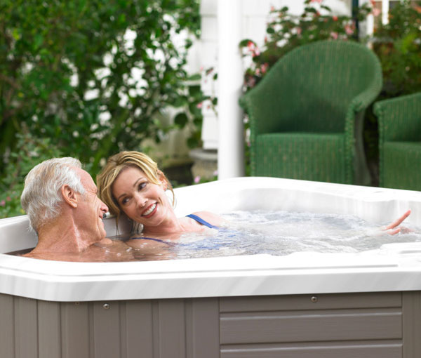 Couple relaxing and enjoying their Aventine Spa | Caldera Spas available at the Recreational Warehouse Southwest Florida (Naples, Fort Myers and Port Charlotte Locations) Pool Warehouse