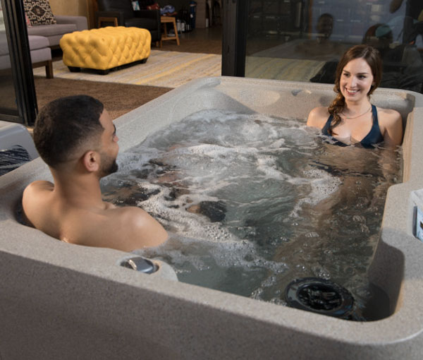 Couple spending quality time in Mini Hot Tub Spa | Freeflow Spas available at the Recreational Warehouse Southwest Florida (Naples, Fort Myers and Port Charlotte Locations) Pool Warehouse