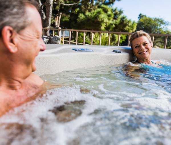 Couple enjoying quality time in Tristar Hot Tub Spa | Freeflow Spas available at the Recreational Warehouse Southwest Florida (Naples, Fort Myers and Port Charlotte Locations) Pool Warehouse
