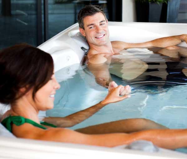 Couple enjoying their Tarino Hot Tub Caldera Spa | Caldera Spas available at the Recreational Warehouse Southwest Florida (Naples, Fort Myers and Port Charlotte Locations) Pool Warehouse