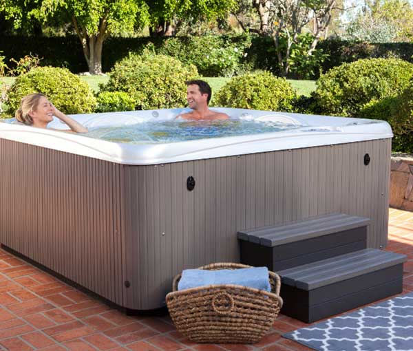 Couple enjoying time in their Rhythm Hot Tub Spa | Hot Springs Spas available at the Recreational Warehouse Southwest Florida (Naples, Fort Myers and Port Charlotte Locations) Pool Warehouse