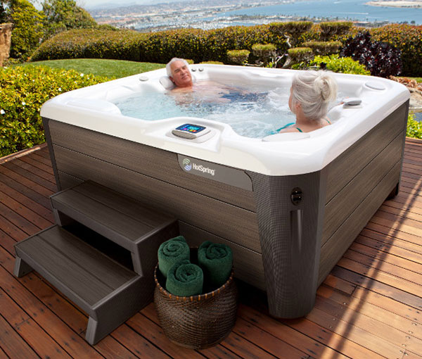 Couple lounging in their Jetsetter Hot Tub Spa   Hot Springs Spas available at the Recreational Warehouse Southwest Florida (Naples, Fort Myers and Port Charlotte Locations) Pool Warehouse