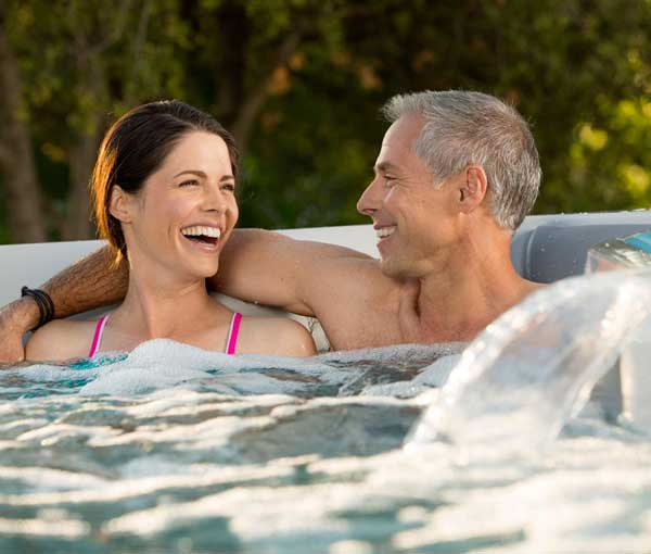 Couple relaxing in E700 Endless Pool Seat Jet Details | Endless Pools Fitness Systems available at the Recreational Warehouse Southwest Florida (Naples, Fort Myers and Port Charlotte Locations) Pool Warehouse