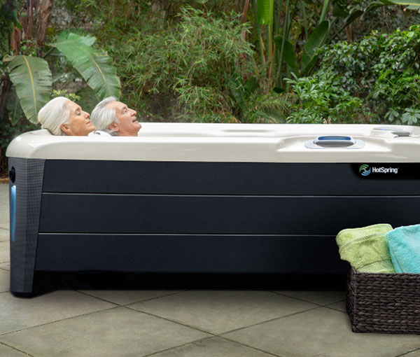 Couple relaxing in their Jetsetter Hot Tub Spa | Hot Springs Spas available at the Recreational Warehouse Southwest Florida (Naples, Fort Myers and Port Charlotte Locations) Pool Warehouse