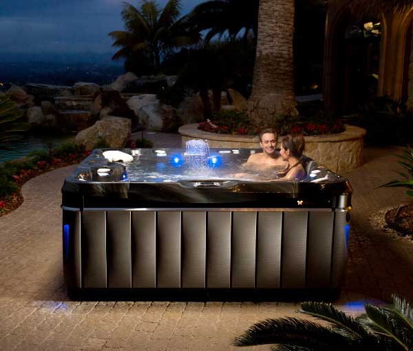 Couple relaxing in Niagara hot tub | Caldera Spas available at the Recreational Warehouse Southwest Florida (Naples, Fort Myers and Port Charlotte Locations) Pool Warehouse