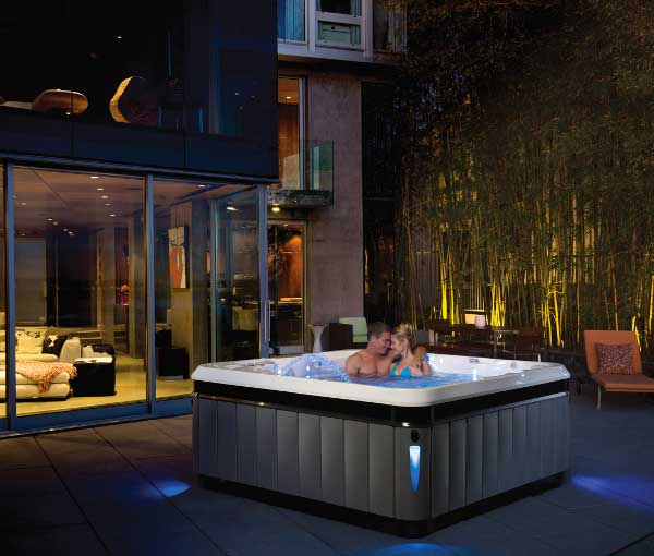 Couple enjoying quality time in their Tahitian Hot Tub   Caldera Spas available at the Recreational Warehouse Southwest Florida (Naples, Fort Myers and Port Charlotte Locations) Pool Warehouse