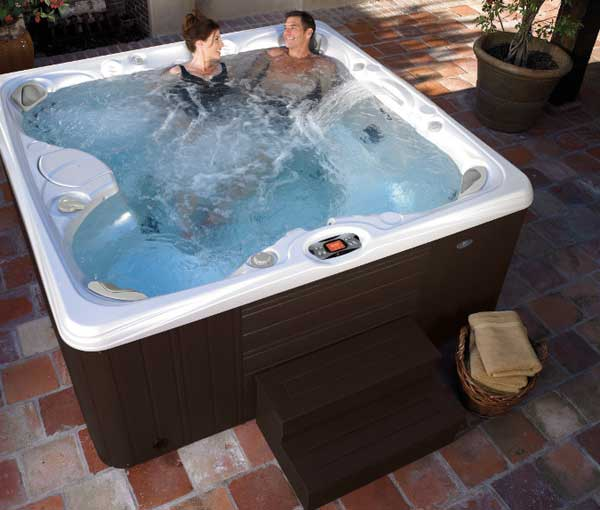 Couple enjoying quality time in Salina Hot Tub | Caldera Spas available at the Recreational Warehouse Southwest Florida (Naples, Fort Myers and Port Charlotte Locations) Pool Warehouse