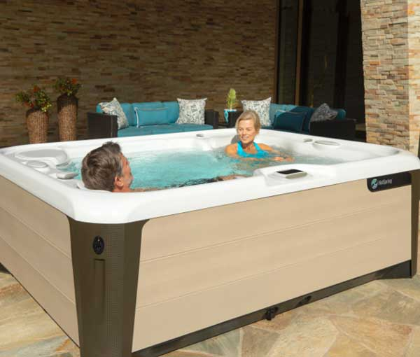 Couple relaxing in Triumph Hot Tub Spa | Hot Springs Spas available at the Recreational Warehouse Southwest Florida (Naples, Fort Myers and Port Charlotte Locations) Pool Warehouse
