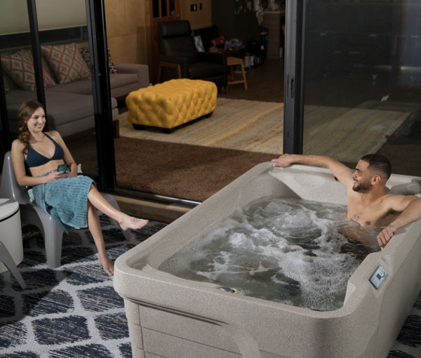 Couple spending quality time with Mini Hot Tub Spa | Freeflow Spas available at the Recreational Warehouse Southwest Florida (Naples, Fort Myers and Port Charlotte Locations) Pool Warehouse