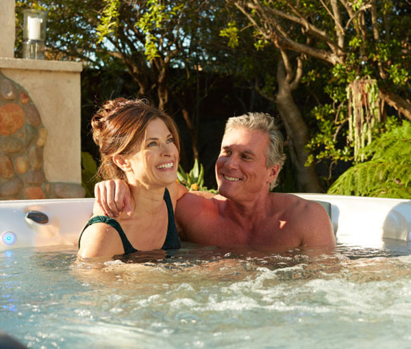 Couple enjoying quality time in Martinique Hot Tub | Caldera Spas available at the Recreational Warehouse Southwest Florida (Naples, Fort Myers and Port Charlotte Locations) Pool Warehouse