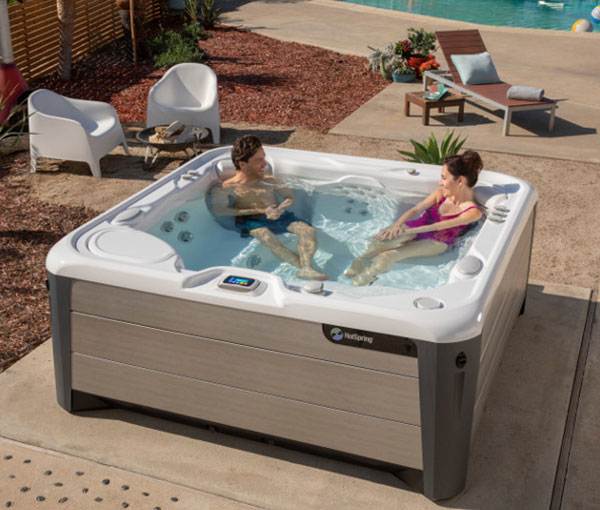 Couple spending quality time in Vanguard Hot Tub Spa | Hot Springs Spas available at the Recreational Warehouse Southwest Florida (Naples, Fort Myers and Port Charlotte Locations) Pool Warehouse