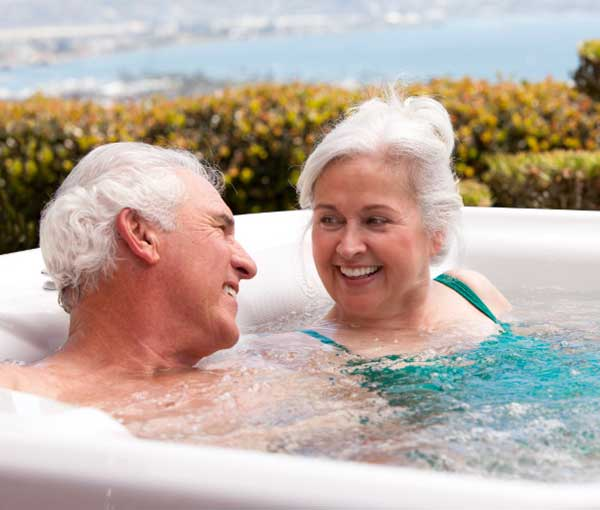 Couple spending time together in their Jetsetter Hot Tub Spa | Hot Springs Spas available at the Recreational Warehouse Southwest Florida (Naples, Fort Myers and Port Charlotte Locations) Pool Warehouse