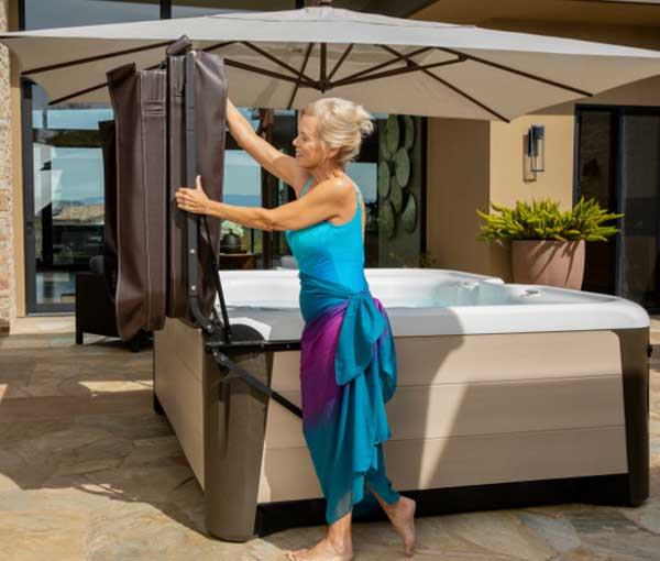 Cover lift on Triumph Hot Tub Spa | Hot Springs Spas available at the Recreational Warehouse Southwest Florida (Naples, Fort Myers and Port Charlotte Locations) Pool Warehouse