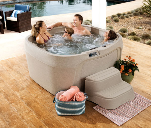 Family enjoying quality time in Cascina Hot Tub Spa | Freeflow Spas available at the Recreational Warehouse Southwest Florida (Naples, Fort Myers and Port Charlotte Locations) Pool Warehouse