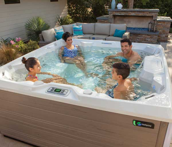 Family enjoying time together in their Pulse Hot Tub Spa | Hot Springs Spas available at the Recreational Warehouse Southwest Florida (Naples, Fort Myers and Port Charlotte Locations) Pool Warehouse