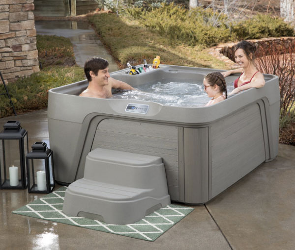 Family relaxing in Azure Hot Tub Spa | Freeflow Spas available at the Recreational Warehouse Southwest Florida (Naples, Fort Myers and Port Charlotte Locations) Pool Warehouse