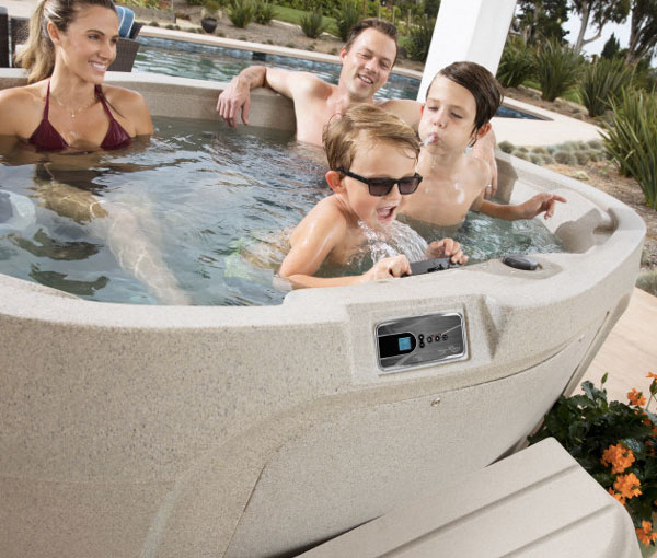 Family spending quality time in Cascina Hot Tub Spa | Freeflow Spas available at the Recreational Warehouse Southwest Florida (Naples, Fort Myers and Port Charlotte Locations) Pool Warehouse