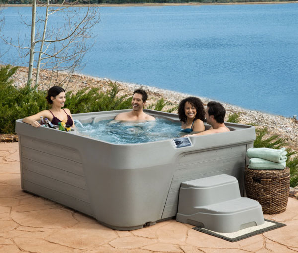 Family chatting in Excursion Hot Tub Spa | Freeflow Spas available at the Recreational Warehouse Southwest Florida (Naples, Fort Myers and Port Charlotte Locations) Pool Warehouse