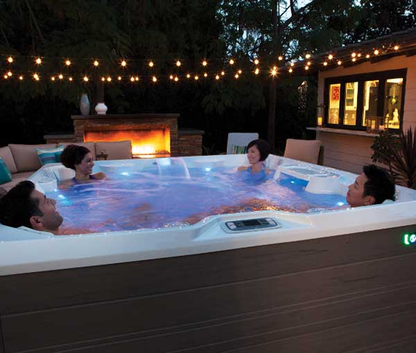 Group of friends relaxing in their Pulse Hot Tub Spa | Hot Springs Spas available at the Recreational Warehouse Southwest Florida (Naples, Fort Myers and Port Charlotte Locations) Pool Warehouse