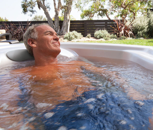 Gentleman relaxing in TX Hot Tub Spa | Hot Springs Spas available at the Recreational Warehouse Southwest Florida (Naples, Fort Myers and Port Charlotte Locations) Pool Warehouse