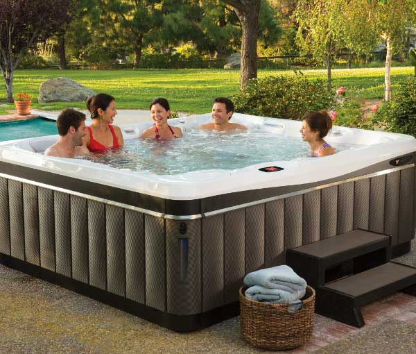 Group of friends enjoying their Cantabria Hot Tub Spa | Caldera Spas available at the Recreational Warehouse Southwest Florida (Naples, Fort Myers and Port Charlotte Locations) Pool Warehouse