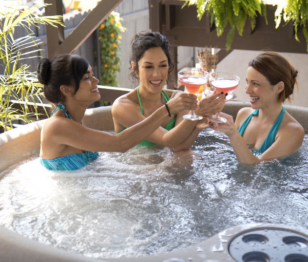 Group of girlfriends having cocktails in Aptos Hot Tub Spa | Freeflow Spas available at the Recreational Warehouse Southwest Florida (Naples, Fort Myers and Port Charlotte Locations) Pool Warehouse