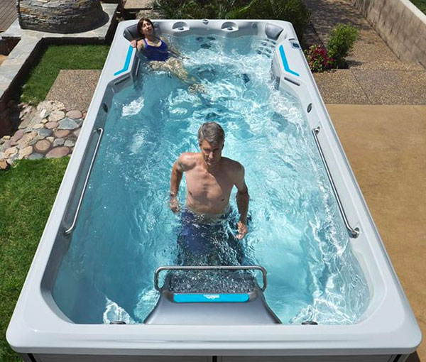Man exercising in E500 Endless Pool   Endless Pools Fitness Systems available at the Recreational Warehouse Southwest Florida (Naples, Fort Myers and Port Charlotte Locations) Pool Warehouse