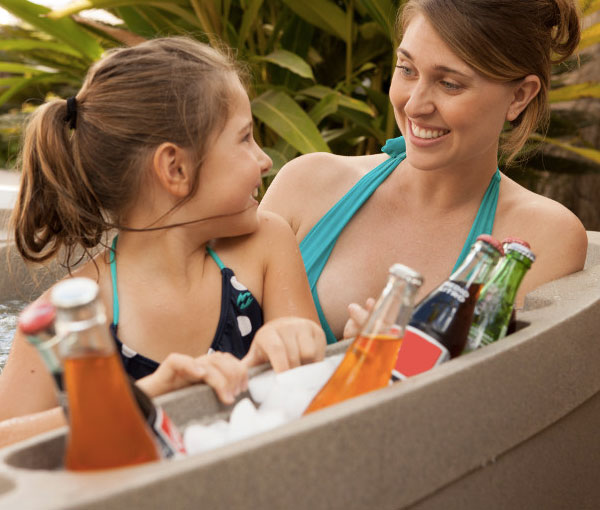 Mother and daughter spending quality time in Monterey Hot Tub Spa | Freeflow Spas available at the Recreational Warehouse Southwest Florida (Naples, Fort Myers and Port Charlotte Locations) Pool Warehouse