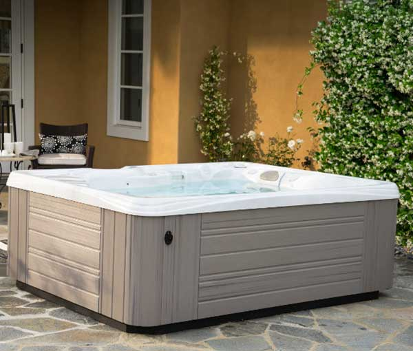 Patio setting of Kauai Caldera Spa | Caldera Spas available at the Recreational Warehouse Southwest Florida (Naples, Fort Myers and Port Charlotte Locations) Pool Warehouse