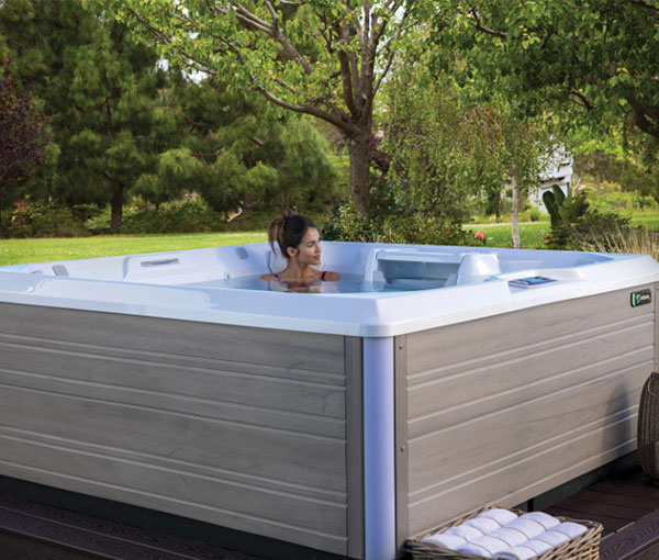 Woman peaceful in Beam Hot Tub Spa | Hot Springs Spas available at the Recreational Warehouse Southwest Florida (Naples, Fort Myers and Port Charlotte Locations) Pool Warehouse