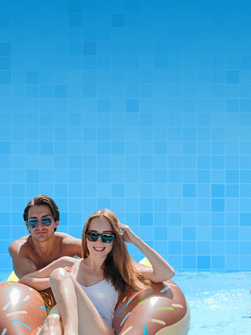 Couple enjoying an above ground pool from The Recreational Warehouse Southwest Florida's Leading Warehouse for Spas, Hot Tubs, Pool Heaters, Pool Supplies, Outdoor Kitchens and more!