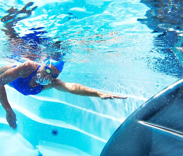 Underwater swimming in E500 Endless Pool   Endless Pools Fitness Systems available at the Recreational Warehouse Southwest Florida (Naples, Fort Myers and Port Charlotte Locations) Pool Warehouse