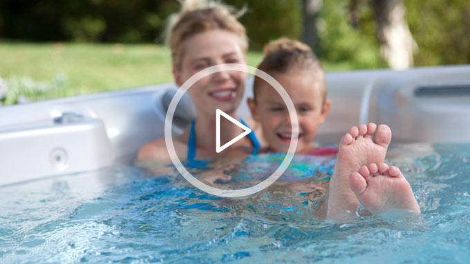 Mom and little girl in a spa from The Recreational Warehouse Southwest Florida's Leading Warehouse for Spas, Hot Tubs, Pool Heaters, Pool Supplies, Outdoor Kitchens and more!