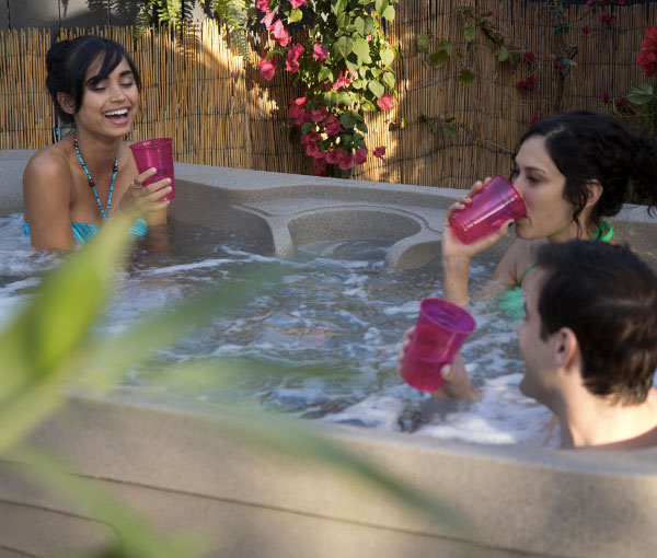 Women drinking cocktails in Azure Hot Tub Spa | Freeflow Spas available at the Recreational Warehouse Southwest Florida (Naples, Fort Myers and Port Charlotte Locations) Pool Warehouse