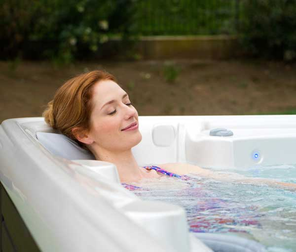 Woman relaxing in her Vanto Hot Tub Caldera Spa | Caldera Spas available at the Recreational Warehouse Southwest Florida (Naples, Fort Myers and Port Charlotte Locations) Pool Warehouse