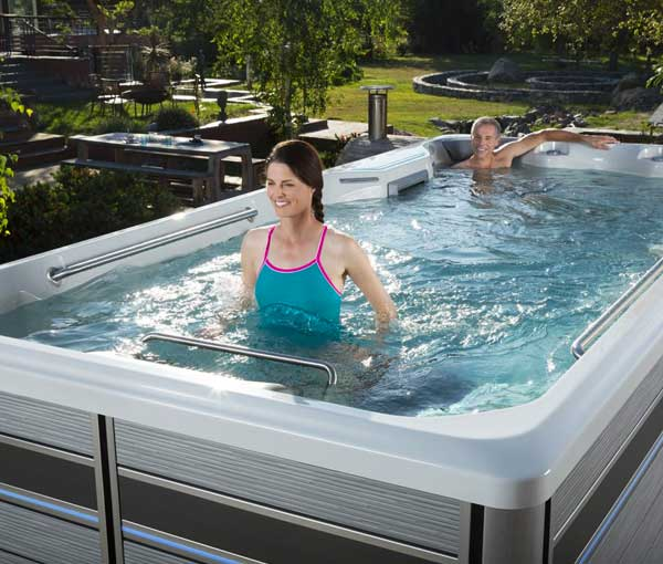 Woman walking on treadmill in E500 Endless Pool   Endless Pools Fitness Systems available at the Recreational Warehouse Southwest Florida (Naples, Fort Myers and Port Charlotte Locations) Pool Warehouse